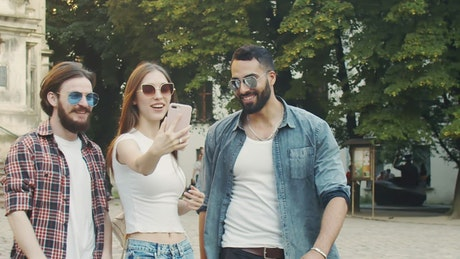 Friends say hello on video call while walking outdoors