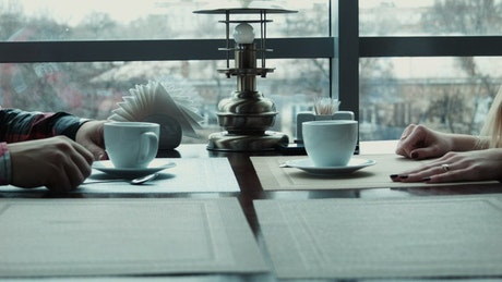 Friends stirring the coffee