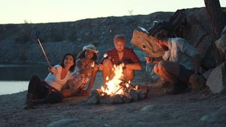 Friends taking a selfie in the campfire