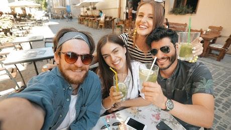 Friends taking social media selfie on holiday