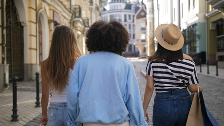 Friends walking the streets after a shopping time