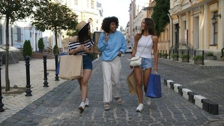 Friends walking through town