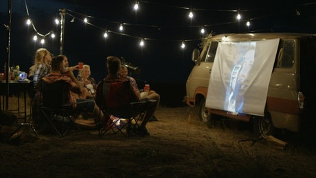 Friends watching a live stream with a projection