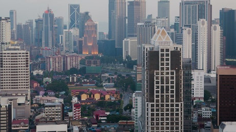 From day to night in Kuala Lumpur cityscape
