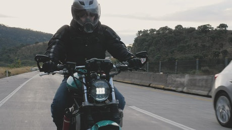 Front view of a biker on highway