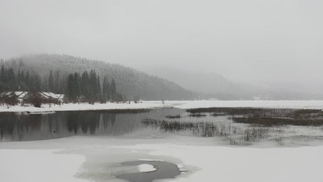 Frozen lake in cold weather and snow
