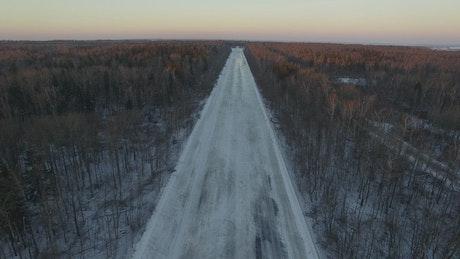 Frozen roads through an empty woodland
