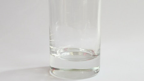 Fruit drink in a glass with ice