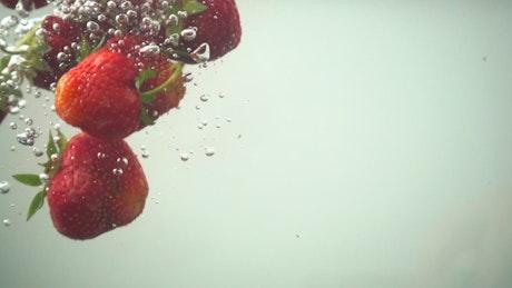 Fruit falling underwater