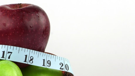 Fruits and measuring tape for diet