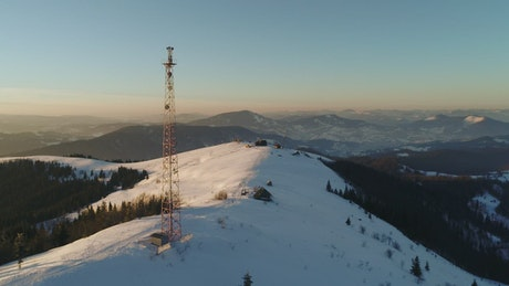 Full aerial shot of a radio tower in the mountains