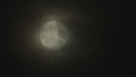 Full moon with a soft haze