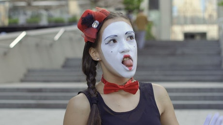 Funny mime acting scared on the street