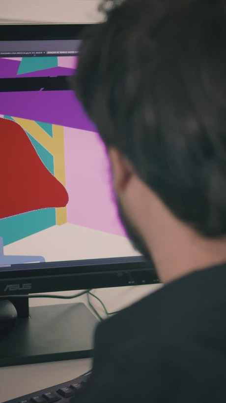 Furniture designer editing an image on his computer