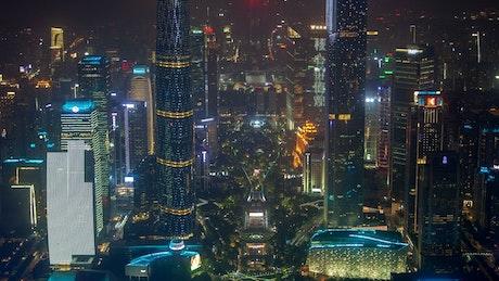 Futuristic buildings flashing in the night