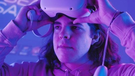 Gamer man puts on VR glasses