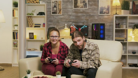 Gaming couple jump up to celebrate victory