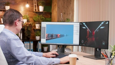 Gaming developer works on 3d graphics in office
