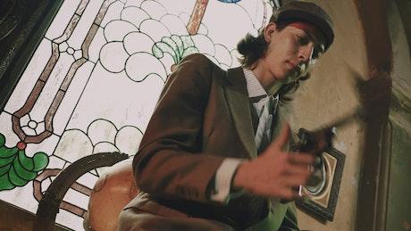Gangster spinning his gun before firing it
