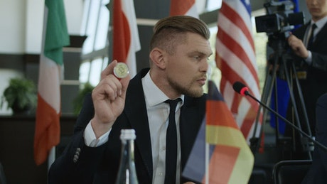 German stateman showing bitcoin in conference