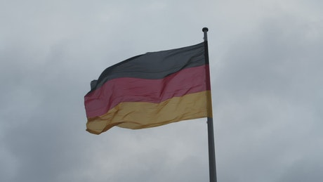 Germany waving flag moved by the wind, low view