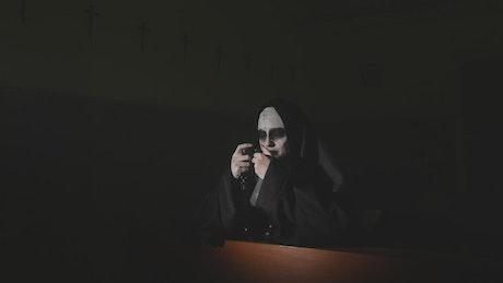 Ghost nun praying in a dark temple