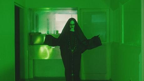 Ghost nun walking slow down an empty hall