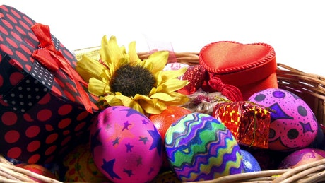 Gifts, flowers and Easter eggs in a basket