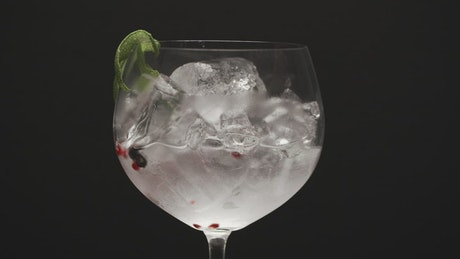 Gin with ice and lime, close up