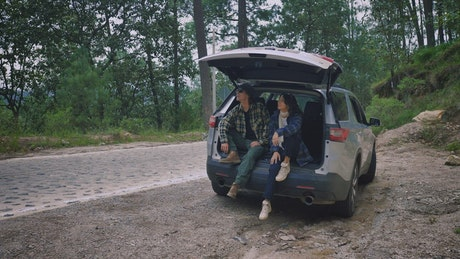 Girl and boy enjoying nature during a road trip