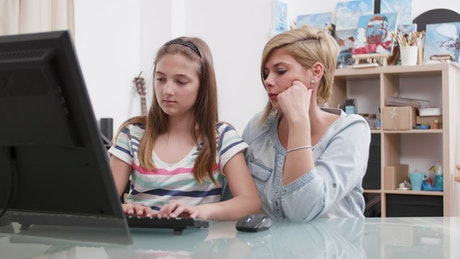 Girl confused by homework gets help from mom