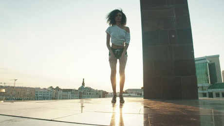 Girl dancing contemporary dance on top of a city