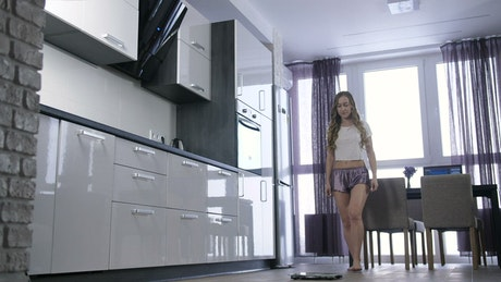 Girl dancing excited after weighing herself