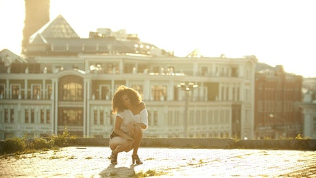 Girl dancing on the roof of a building
