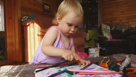 Girl drawing with color pencils