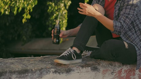 Girl drinking soda outdoors