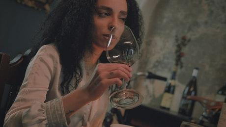Girl finishing wine from a glass on a love date