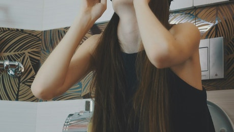 Girl holding a VR headset