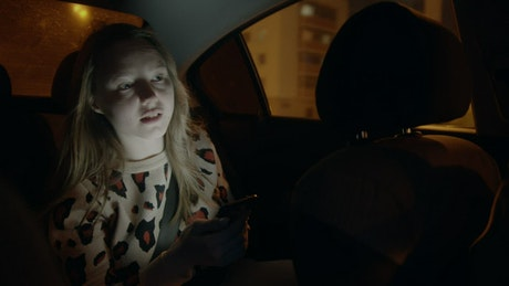 Girl in a car giving directions to the driver