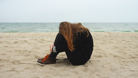 Girl in a relaxed mood on the beach