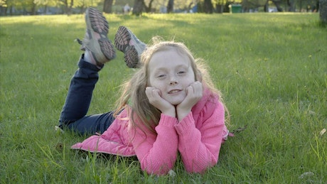 Girl laying down in the park