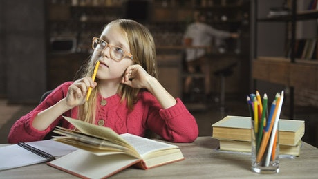 Girl learning at home