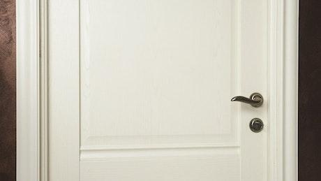 Girl looking through a door