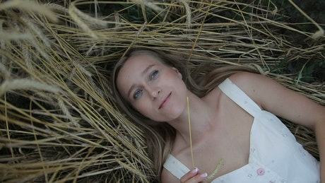Girl lying on straw in a spinning portrait