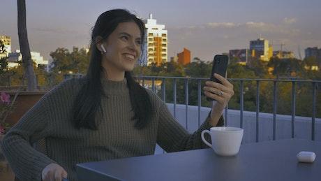 Girl on a terrace having a video call
