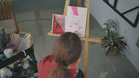 Girl painting a picture on an easel