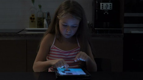 Girl playing a game on a tablet