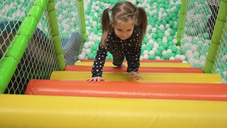 Girl playing in an indoor park