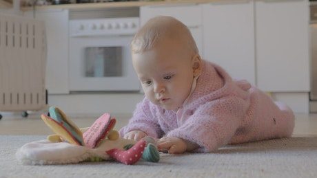 Girl playing on the kitchen floor