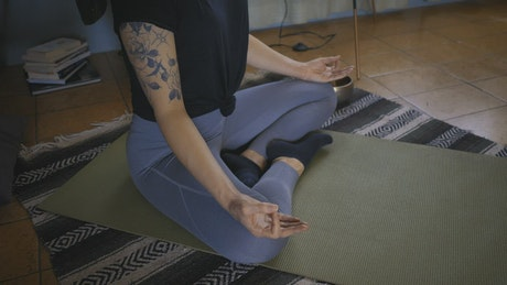 Girl practicing yoga on the floor of her home